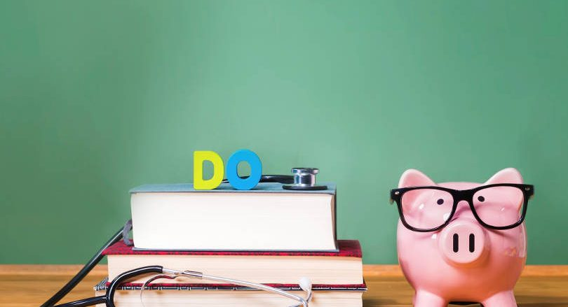 books-and-piggy-bank-with-glasses